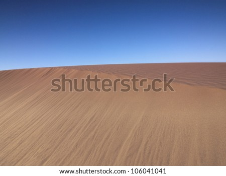 Only sand and  blue sky. - stock photo