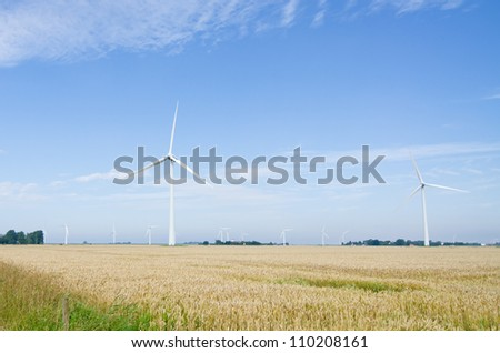 Onshore Eolic park in a grainfield - stock photo