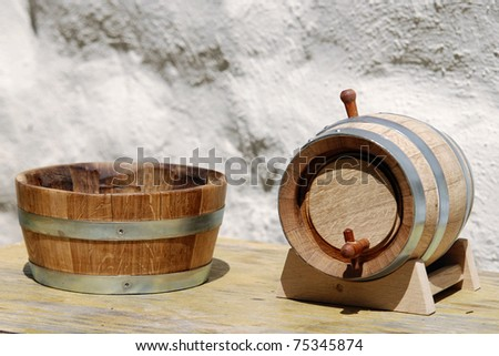 ontainer and wooden keg - stock photo