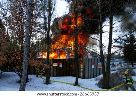 ONTARIO, CANADA – MARCH 13 : Firemen try to put off fires at a hydro substation in Shefford Road in Ottawa, Ontario, Canada on March 13, 2009. The fire leaves 4,400 without power for several hours.
