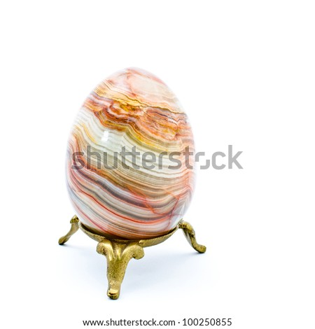 Onyx egg on the rest isolated on white background - stock photo