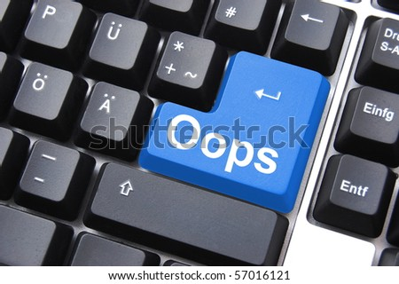oops button on computer keyboard showing error or mistake concept - stock photo