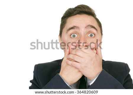 Oops! Closeup shot of a businessman closing his mouth with his hands silent isolated on white copyspace on the side - stock photo
