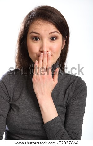 Oops hand signal by pretty young woman with hand over mouth - stock photo