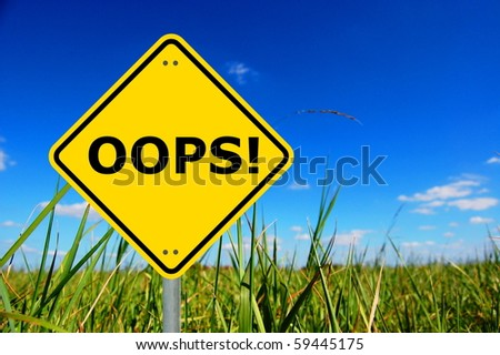 oops written on a yellow road traffic sign - stock photo