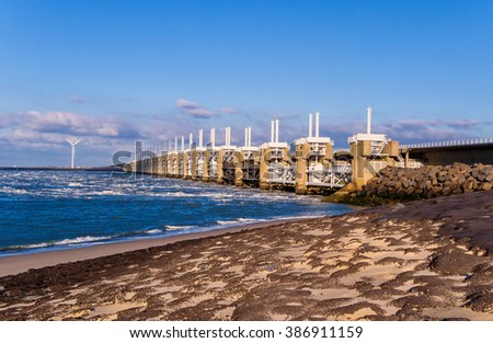 Oosterscheldekering is a flood barrier in the Oosterschelde river protecting the inland from floods, part of the Dutch Delta Works - stock photo