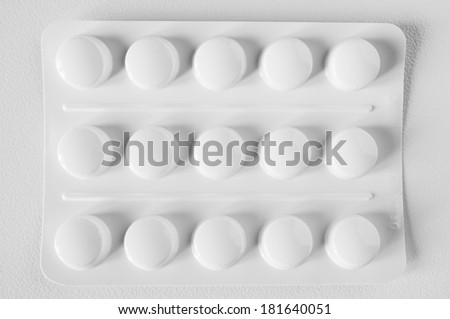 opaque blister pack (white) - stock photo