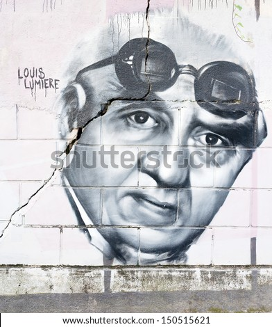 OPATIJA CROATIA - CIRCA JULY 2013: Louis Lumiere graffiti in Angiolina park, Opatija circa July 2013. Faces on this wall represent famous people who visited this Croatian touristic city. - stock photo