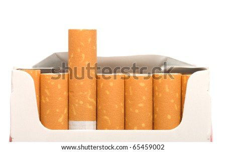 Open a pack of filtered cigarettes closeup isolated on a white background.