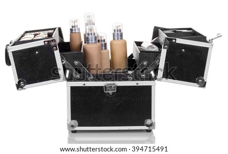 Open a professional bag with cosmetics isolated on white background. - stock photo