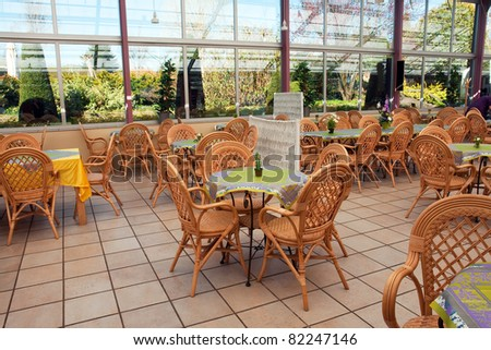 Open air beautiful summer cafeteria cafe coffee shop restaurant bistro in lovely colors - stock photo