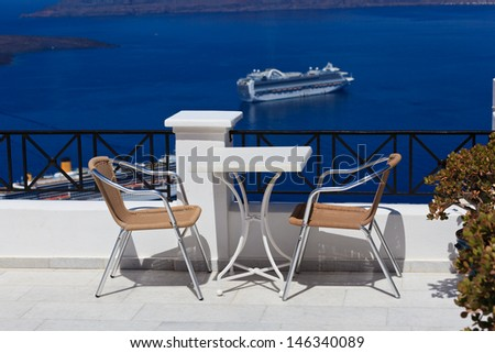 open air cafe with beautiful view in Santorini, Greece - stock photo