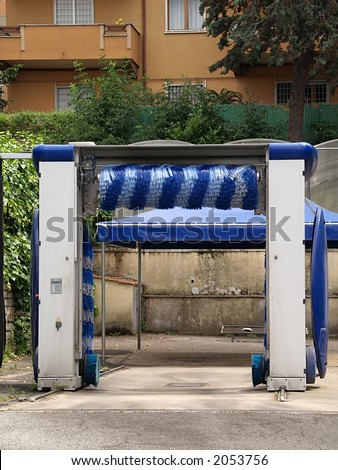 Open air car washing center in suburbs of Rome, close-up - stock photo