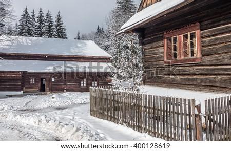 Open-air museum. Zuberec Brestova. Village house. Rural house. Old House. Wooden house. Village cottage. Rural cottage. Old cottage. Wooden cottage. Winter in village. Typical village. Slovak village. - stock photo