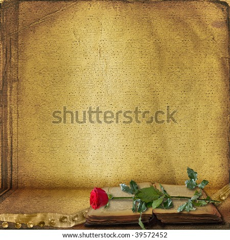Open ancient book with beautiful red rose - stock photo