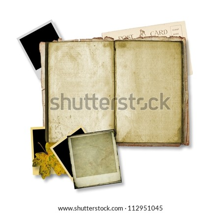 Open ancient book with instant photos - stock photo