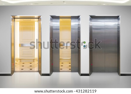 Open and closed chrome metal office building elevator doors realistic photo. Lift transportation floor to floors with push switch for up and down.                                - stock photo