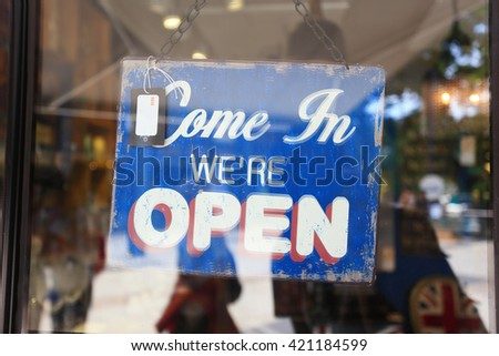 Open and closed sign (Show amount 136 HKD) at front glass door