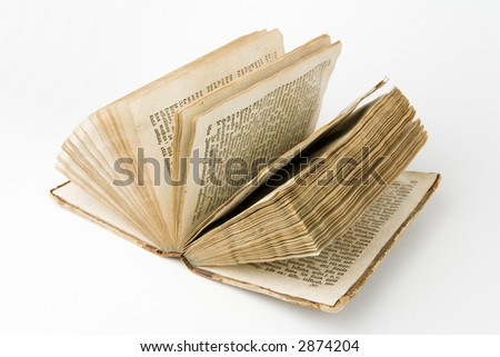 Open antique book on a white background - stock photo