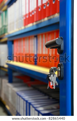 open archive door with keys on the lock - stock photo