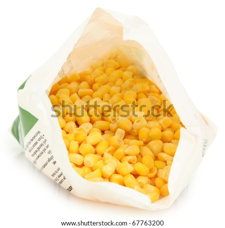 Open bag of uncooked frozen corn niblet over white with clipping path. - stock photo