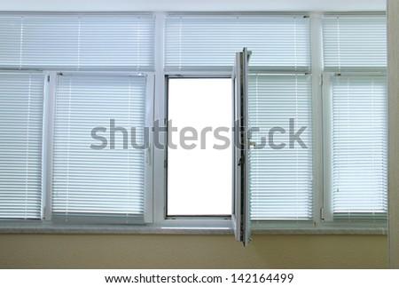 Open balcony window overlooking street - stock photo