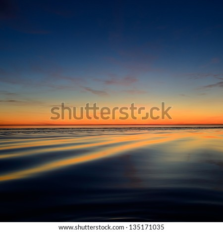 open Baltic sea at the sunset - stock photo