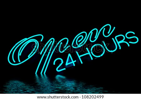 open bar restaurant 24 hours blue neon sign with water reflection - stock photo