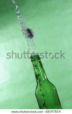 Open beer bottle with stream fresh drink