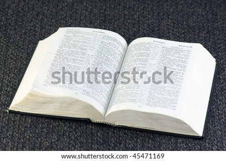 open Bible rests on a brown fabric