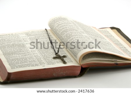 open bible with a cross of jesus on white background