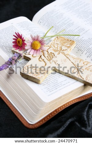 Open Bible with flowers and an ornate cross
