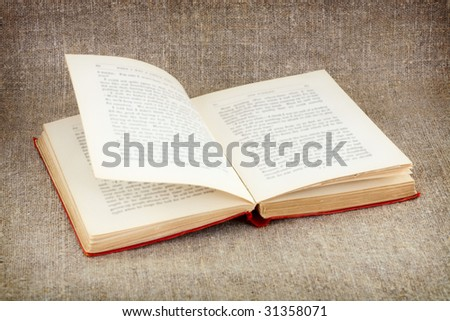 Open big old book on canvas background