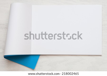 Open blank brochure on a wooden table - stock photo
