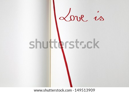 Open blank exercise book with red bookmark (love is) - stock photo