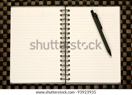 Open blank note book on bamboo texture