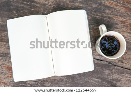 Open blank note book with coffee cup on grunge wood - stock photo
