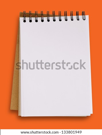 Open blank notebook isolated on orange background, clipping path.