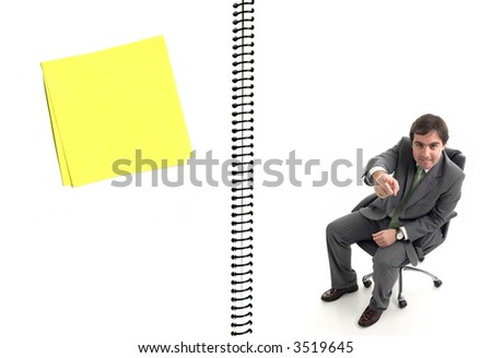 Open blank notebook with a bussinessman a a post-it - stock photo