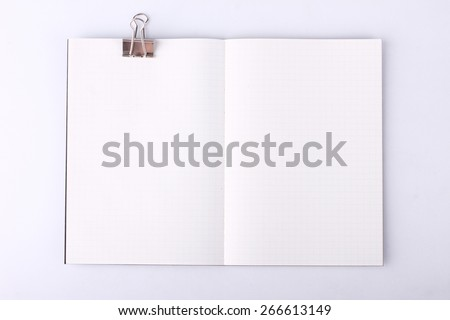 open blank notebook with paper clip - stock photo