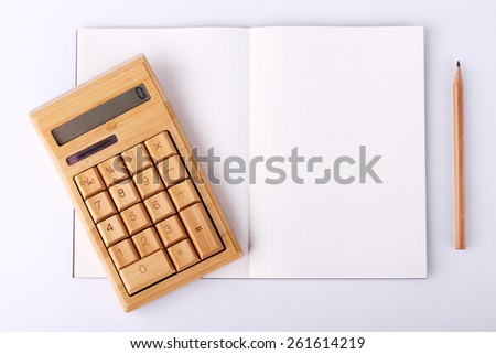 open blank notebook with wooden pencil and calculating machine, business concept - stock photo