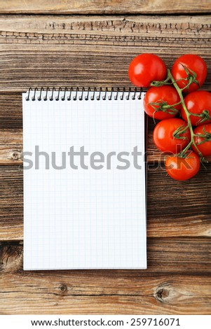 Open blank recipe book on brown wooden background