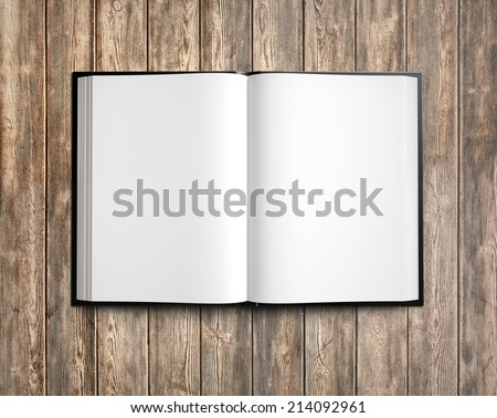 Open blank textbook on wood background - stock photo