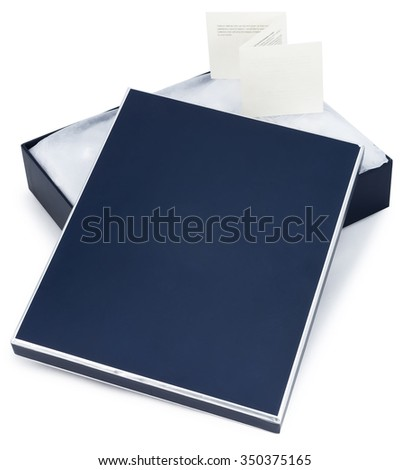 Open blue box with with a gift inside and note isolated on white background - stock photo