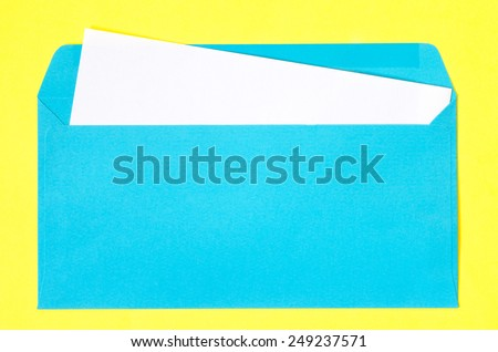 open blue, envelope with  blank paper on yellow background - stock photo