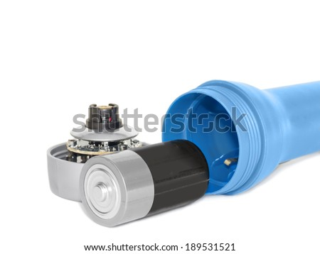 Open blue plastic flashlight, cap and battery. Inside front view showing electronic components and battery compartment. Horizontal photo, isolated on a white background.