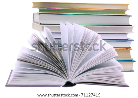 Open book against a background of books isolated - stock photo