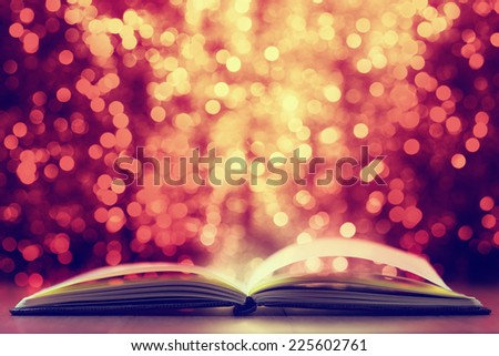 Open book against  defocused  lights abstract background