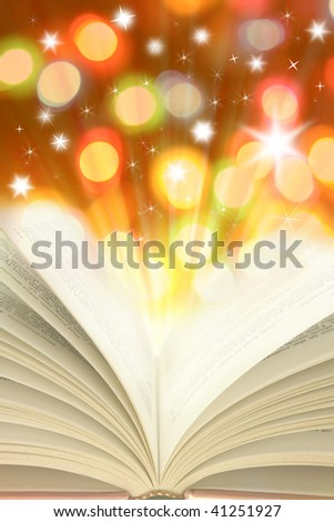 Open book and colorful lights - stock photo