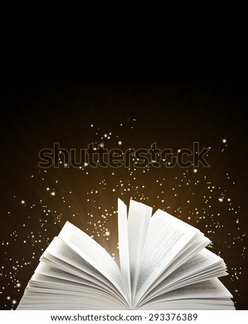 Open book and magic sparks on black background - stock photo
